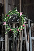Gardening tools and wreath of carnations