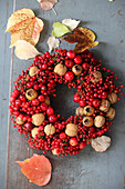 Wreath of red berries, walnuts and medlars