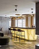 Circular lamps above lit bar area