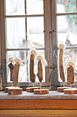 Hand-crafted driftwood angels on windowsill