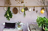 Mediterranean decorations hung on lilac wall on Mediterranean loggia