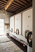 Cistern in foyer of converted wine cellar