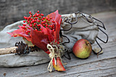Posy of small rose hips and red Virginia creeper leaves