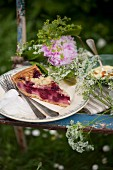 Cake, pudding and flowers on chair for garden picnic