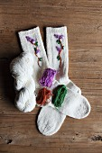 Hand-knitted woollen socks embroidered with flowers and matching wools
