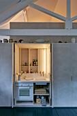 Miniature kitchen with lighting hidden in cupboard