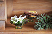 Hellebore flowers and moss in glass bowl
