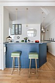Two retro bar stools at counter in restored period apartment