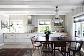 Dining area in white country-house kitchen