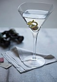 Close-up of Martini on napkin, opera glasses and tickets