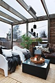 Comfortable lounge area on roofed terrace