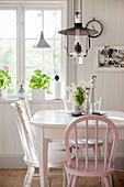 Sunny dining room in Scandinavian, country-house style