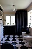 Black-and-white bathroom with chequered floor