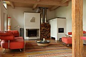 Fireplace and stacked firewood in lounge area