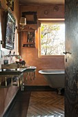 View through open door into vintage bathroom with historical ambiance