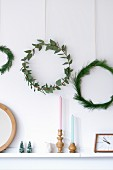 Simple wreaths of eucalyptus and pine branches on wall