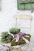 Romantic moss cushion and heather on vintage garden chair