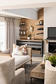 Beige and grey living room with one wood-clad wall