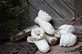 White, hand-made felt slippers and knitting in front of rustic wooden door