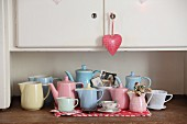 Collection of retro pastel jugs on kitchen dresser