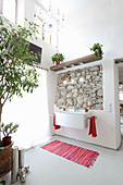 Exposed rustic masonry in renovated bathroom
