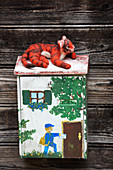 Hand-made, felted, woollen tiger on letterbox
