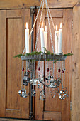 DIY chandelier made from cake tins and candles