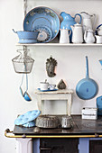 Old kitchen utensils made from blue and white enamel
