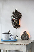 Wall lamp made from old perforated cake tin