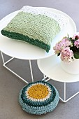 Crocheted cushion made from T-shirt yarn on round side table