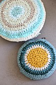 Crocheted cushions made from T-shirt yarn in shade of blue