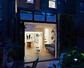 Angled view of sitting room from outside at dusk