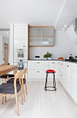 Scandinavian-style wooden chairs and dining table in kitchen