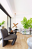 Modern, patterned armchairs in the bright living room with sisal carpet
