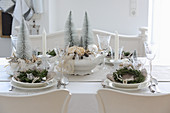 Festively set Christmas table in cream