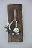 Christmas decorations in bowl of old ladle on wooden board