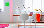 White dining room with neon accents