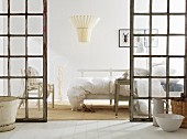 White bedroom with latticed glass doors