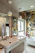 Gold floral mosaic above bathtub in luxurious bathroom