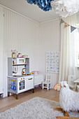 Play kitchen and striped wallpaper in child's bedroom