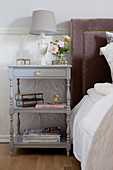 Grey bedside table with turned legs