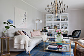 Pale sofa and blue rug in classic living room