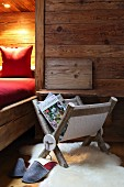 Magazine rack hand-made from branches and felt in cabin-style interior
