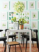 Gallery of vegetable pictures in white frames in dining area