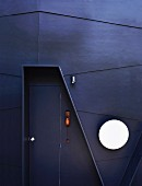 Designer entrance door in a dark facade