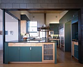 Open-plan kitchen with teal cupboards