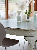 Rustic dining table and plastic chair