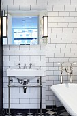 White bathroom with sink and bathtub