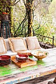 Rustic table and bench on vintage-style terrace