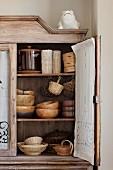 Wooden bowls in an vintage kitchen cupboard